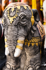 Elephant statue decorated with gold at shrine