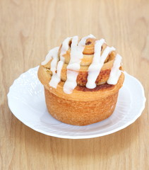 Delicious Cinnamon roll on wood tray background