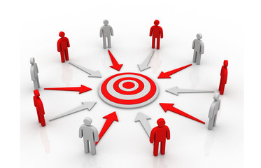 A group of business people in a circle aiming for the target .