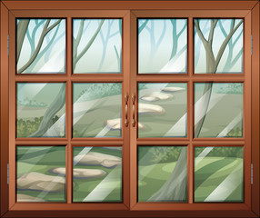 A closed window with a view of the forest
