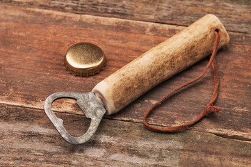 A simple bottle opener and a metal cap