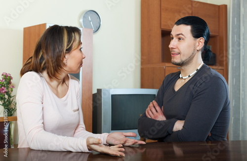 Serious man with wife talking