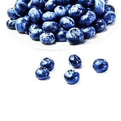 Fresh Blueberries on white plate isolated on white background cl