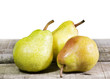 three pears on wooden table