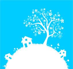 Wiese mit Häusern und Baum