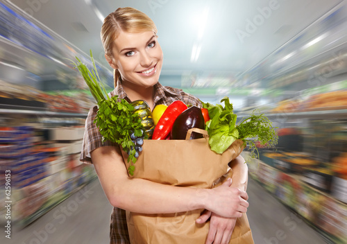 woman shopping for fruits and vegetables in produce department o