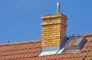 Close up of house roof with chimney