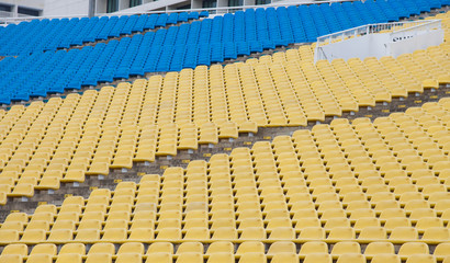 Stadium seats in yellow and blue color