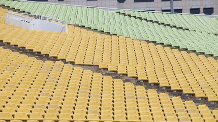Stadium seats in yellow and green color