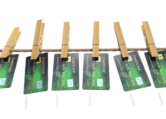 Credit card hanging on clothesline