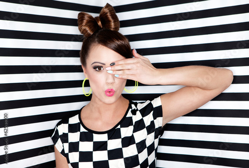 Beautiful  young woman  on stripy background