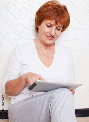 Mid woman with tablet pc