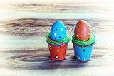 Easter background with eggs in buckets