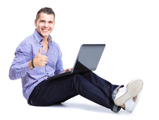 happy man working on laptop in casuals