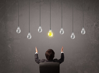 Businness guy in front of idea light bulbs concept