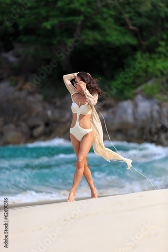 Sexy Slim woman walking at beach