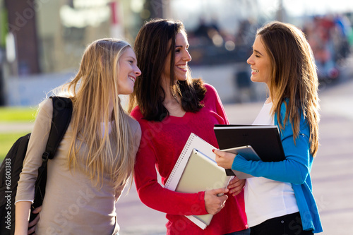 Friends talking in the street after class