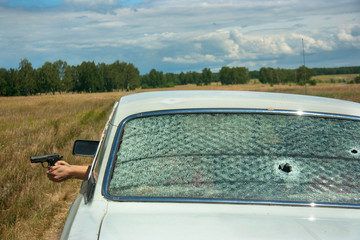 Skirmish, chase and shooting on car