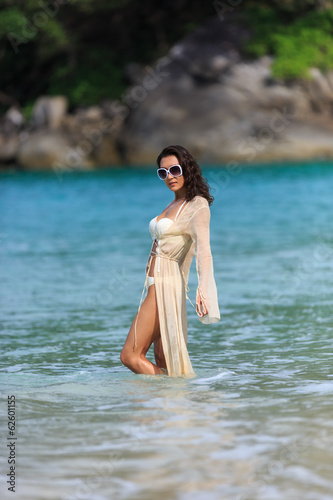 Sexy Slim woman Posing in a waters