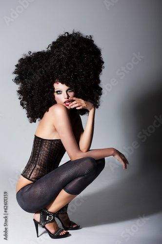 Fashion Model in Huge Wig. Frizzy Extreme Hairstyle