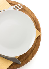 plate, knife and fork  at cutting board
