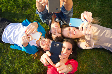 A group of friends taking photos with a smartphone