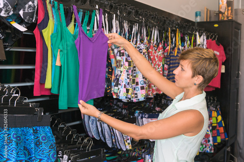 woman buys in the store swimsuit, bikini