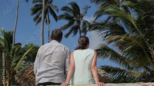 Business couple sitting and relaxing in exotic location