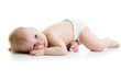 Baby boy in diaper lying on floor isolated