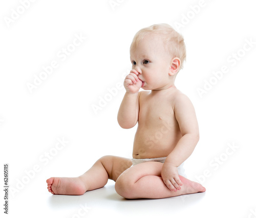 Baby boy suckling thumb isolated on white