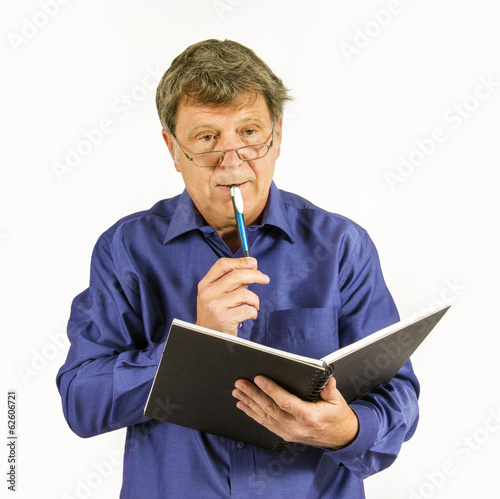 man in blue shirt writes in his diary