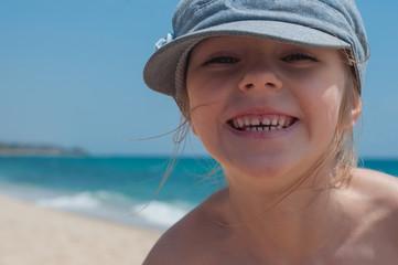 Cute little girl in denim cap