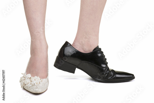 Woman wearing men's shoes of lesbian marriage