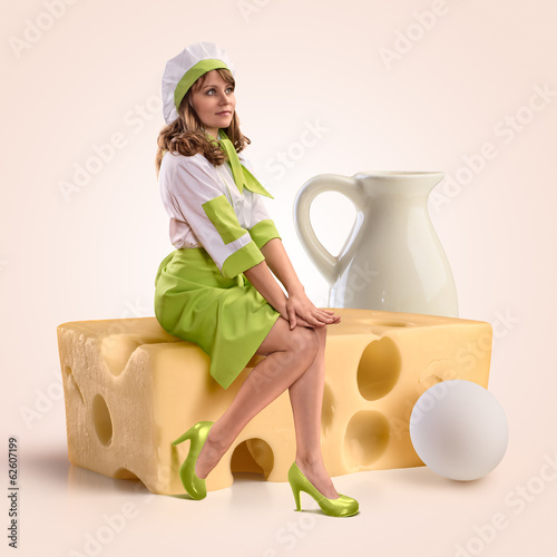 cook girl sitting on a piece of cheese