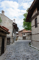 View of paved walkway with traditional bulgarian architecture