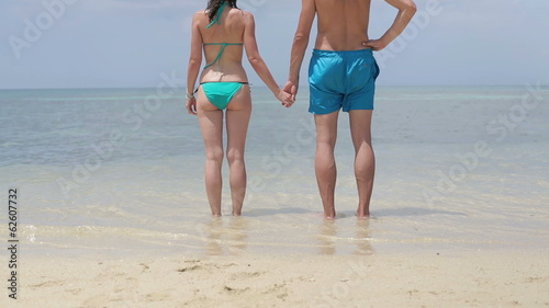 Couple in swimwear standing in the sea