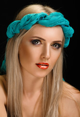 portrait young woman with turquoise bandag on black background