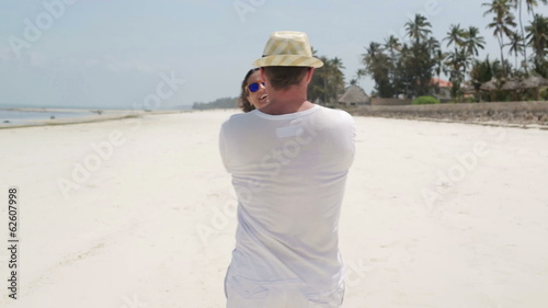 Young couple in love having fun on beautiful exotic beach
