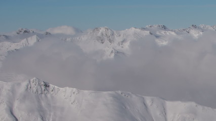 Tirol  mountains covered in clouds winter landscapes