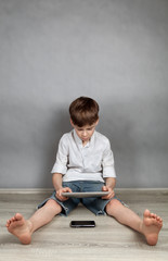 Boy playing on tablet