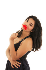 Woman with sweet sugar lollipop