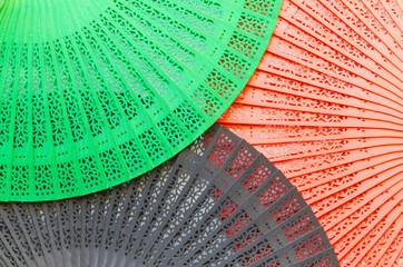 Three wooden fans