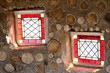 Two small red stained glass windows
