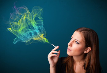Pretty lady smoking cigarette with colorful smoke