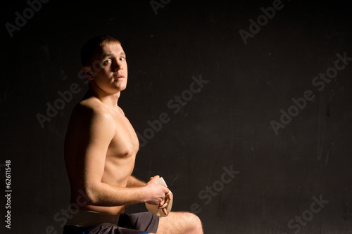 Athletic young boxer preparing for a fight