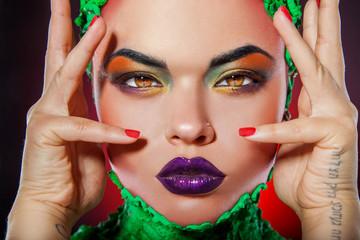 Pretty caucasian girl with creative multicolored makeup