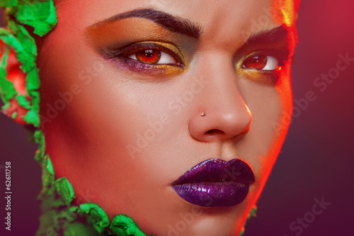 Voluptuous caucasian woman with creative makeup in studio