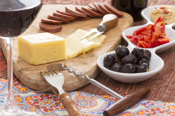 Havarti cheese and savory snacks with red wine