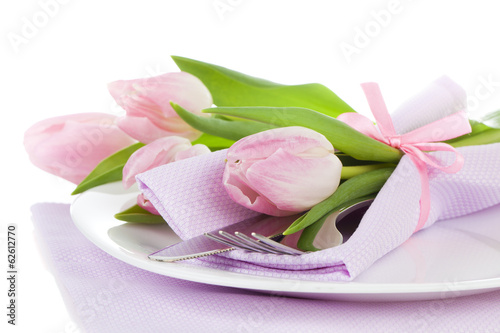 Romantic dinner / table setting with roses tulips and cutlery, o