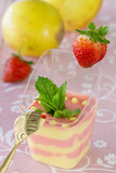 Passion fruit and strawberry mousse  on pink background